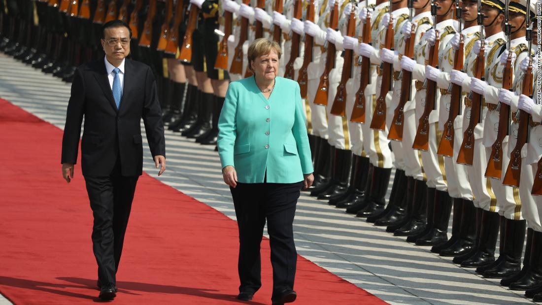 Caught between human rights and trade, Angela Merkel lands in China