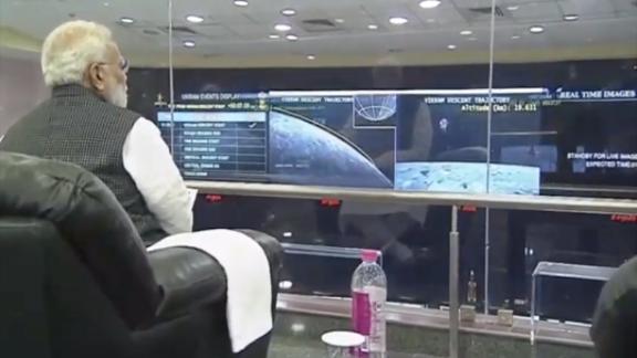 Prime Minister Narendra Modi  watching the landing.