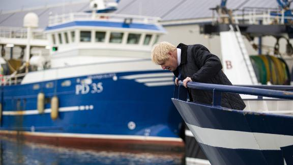 Britain's Prime Minister Boris Johnson looks to the water from a boat during a visit to Scotland.