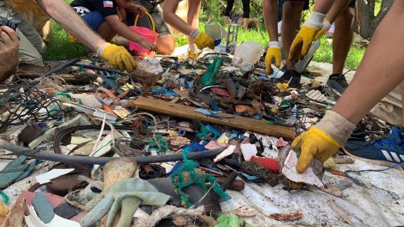 A crew sorts through marine debris on Easter Island.