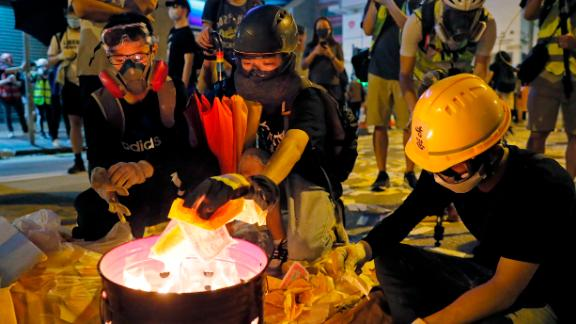 Protesters burn paper money to pay their respects to injured protesters.