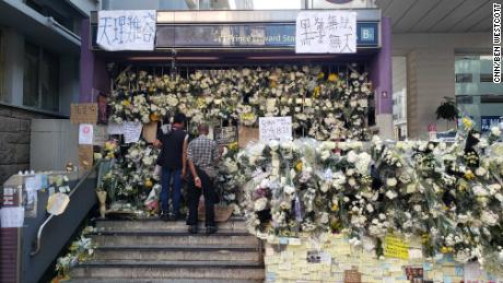 Floral stands close the entrance to the ICC in Hong Kong, Prince Edward, after protesters accused police of using excessive violence at the station.