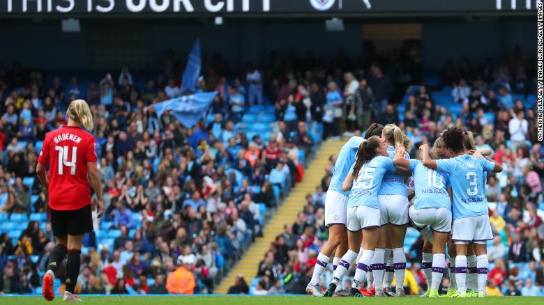 Manchester City players celebrate Caroline Weir's winning goal.