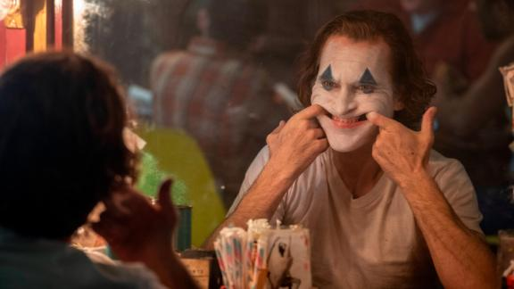 "Joaquin Phoenix practices his creepy smile in ""Joker."""