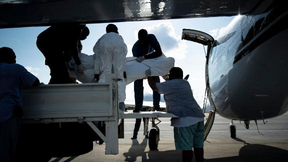 Bodies are loaded onto a plane in Marsh Harbour on Saturday, September 7.