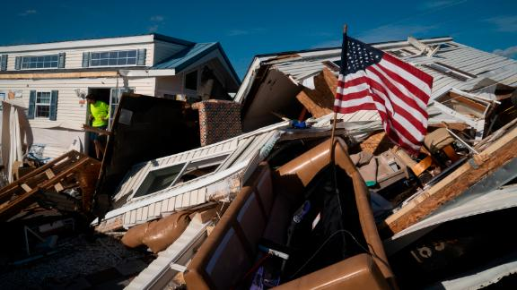 A man surveys damage at the Boardwalk RV Park in Emerald Isle, North Carolina, on Friday, September 6.