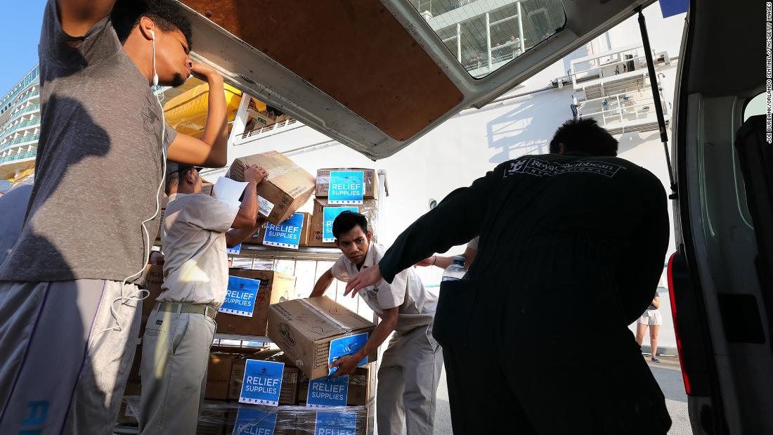 Boxes of food are loaded onto trucks in Freeport, Bahamas, on September 7.