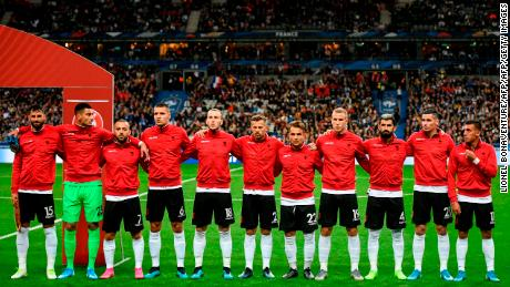Albania's players line up for the national anthem -- only for the wrong song to be played