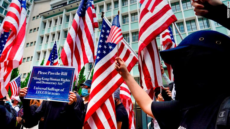 Protesters wave United States flags during a protest in Hong Kong on Sunday September 8.