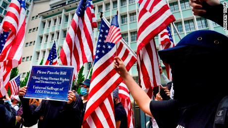 Protesters wave US national flags as they march to the US consulate in Hong Kong on September 8.