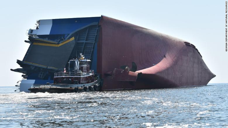 Crew members of capsized cargo ship rescued