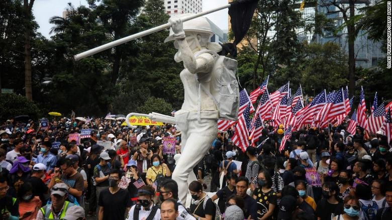 Protesters wave US national flags as they march from Chater Garden to the US Consulate in Hong Kong on September 8.