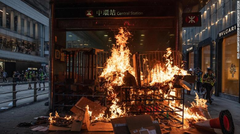 A barricade burns at an entrance to a train statio on September 8 in Hong Kong, China.