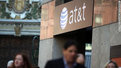 SAN FRANCISCO, CA - OCTOBER 23:  Pedestrians walk by an AT&T store on October 23, 2013 in San Francisco, California. AT&T is going to report third-quarter earnings after the closing bell.  (Photo by Justin Sullivan/Getty Images)