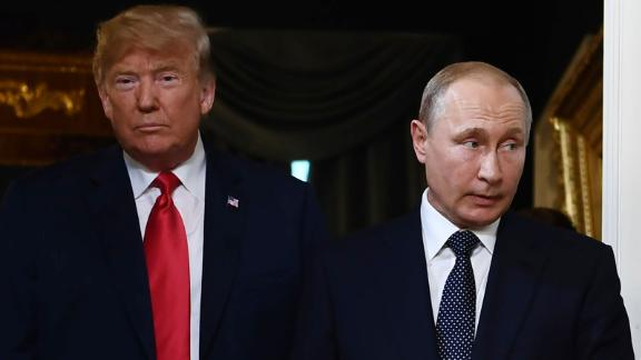 US President Donald Trump (L) and Russian President Vladimir Putin arrive for a meeting in Helsinki, on July 16, 2018.