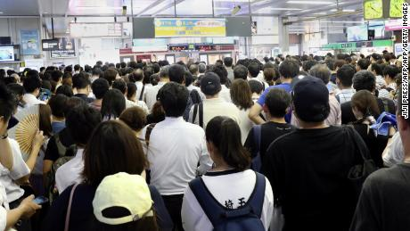 Commuters at a Japan Railways station, where trains were suspended due to Typhoon Faxai in Saitama on September 9, 2019.