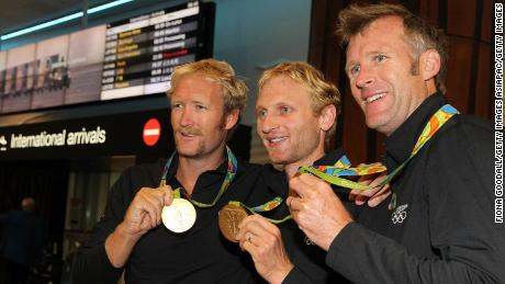 Olympic rowing gold medalists Eric Murray (left),  Hamish Bond (center), and Mahe Drysdale with their 2016 medals.