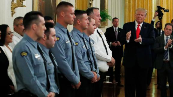 President Donald Trump applauds during a Medal of Valor and Heroic Commendations ceremony for six Dayton, Ohio police officers in the East Room of the White House, Monday, September 9, in Washington, for stopping a mass shooter in August, in Dayton.