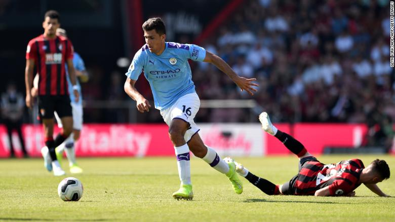 Manchester City's Spanish midfielder Rodri (C) tackles Bournemouth's Welsh midfielder Harry Wilson.