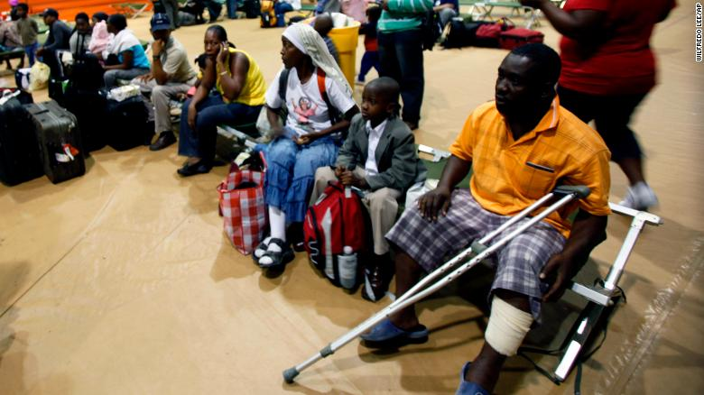 A group of evacuees from Haiti wait for transportation as they clear customs at Homestead Air Reserve Base, Florida, in January 2010.