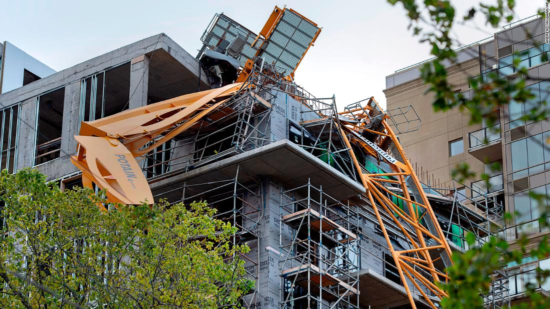 A toppled building crane is draped over a new construction project in Halifax, Nova Scotia, on September 9.