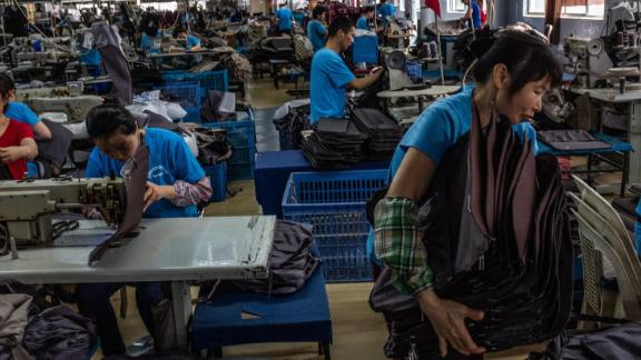 FILE -- Workers at a suitcase factory in Shanghai, China, May 28, 2019. Ahead of a G-7 Summit in Biarritz, President Donald Trump asserted that he has the authority to make good on his threat to force all American businesses to leave China, citing on Twitter a 1977 law that has been used mainly to target terrorists, drug traffickers and pariah states like North Korea. (Lam Yik Fei/The New York Times)