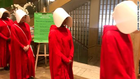 Actors dressed as characters from the new Margaret Atwood novel, The Testaments at the Piccadilly branch of Waterstones as they promote an audience with the author ahead of the midnight release of the new book.