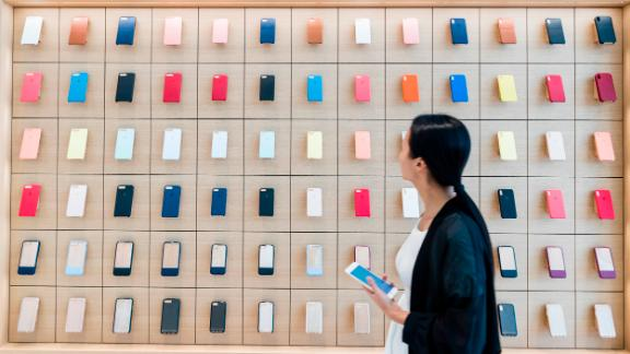 Customer looks at Apple Watch bands displayed, inside of Apple Inc. store in Macau, China, on July 18, 2018.