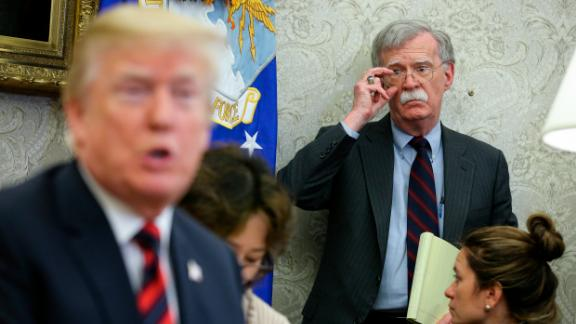 US President Donald Trump speaks as National security advisor John Bolton listens during a meeting with South Korean President Moon Jae-in, in the Oval Office of the White House on May 22, 2018 in Washington DC.  (Oliver Contreras-Pool/Getty Images)