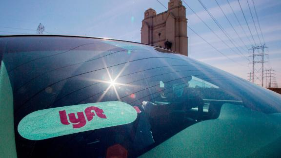 Lyft driver Alejandro Mendez rides his car in downtown Los Angeles, California, March 29, 2019. - Ride-hailing company Lyft made its Initial Public Offering (IPO) on the Nasdaq Stock Market on March 29th. (Photo by Apu Gomes / AFP)        (Photo credit should read APU GOMES/AFP/Getty Images)