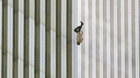 "A man falls from one of the World Trade Center towers. The publication of this photo, taken by Richard Drew, led to a public outcry from people who found it insensitive. Drew sees it differently. On the 10th anniversary of the attacks, he said he considers the falling man an ""unknown soldier"" who he hopes ""represents everyone who had that same fate that day."" It's believed that upwards of 200 people fell or jumped to their deaths after the planes hit the towers."