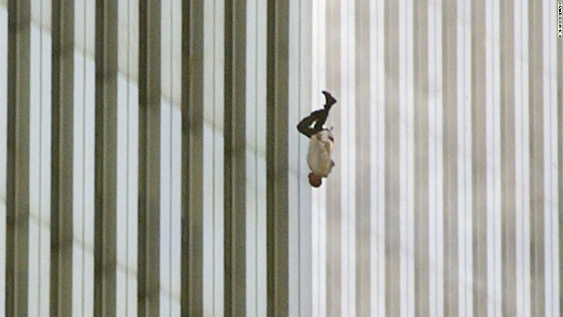 "A man falls from one of the World Trade Center towers. The publication of this photo, taken by Richard Drew, led to a public outcry from people who found it insensitive. Drew sees it differently. <a href=""http://www.thedailybeast.com/articles/2011/09/08/richard-drew-s-the-falling-man-ap-photographer-on-his-iconic-9-11-photo.html"" target=""_blank"">On the 10th anniversary of the attacks,</a> he said he considers the falling man an ""unknown soldier"" who he hopes ""represents everyone who had that same fate that day."" It's believed that upwards of 200 people fell or jumped to their deaths after the planes hit the towers."