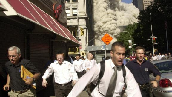 People run as the building collapses.