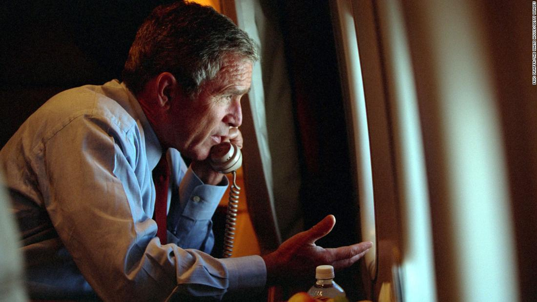 Bush speaks to Cheney aboard Air Force One after departing Offutt Air Force Base in Nebraska. He had flown to Nebraska temporarily for security reasons.