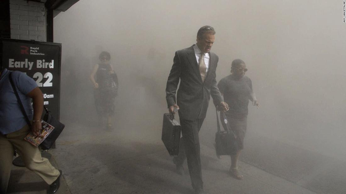People in New York navigate through a dust cloud.