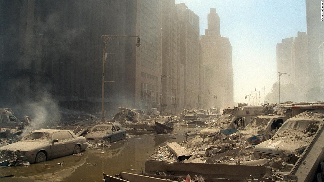 Dust, ash and rubble cover everything on a street in lower Manhattan.