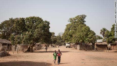 Two young boys walk in the main street of Tiringoulou, northern Central African Republic, on December 22, 2017.  / AFP PHOTO / ALEXIS HUGUET        (Photo credit should read ALEXIS HUGUET/AFP/Getty Images)