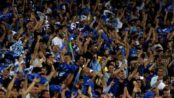 Iranian fans cheer for their team during the AFC Champions League football match Al-Sadd (Qatar) vs Esteghlal FC (Iran) at the Azadi stadium in Tehran on August 27, 2018. (Photo by ATTA KENARE / AFP)        (Photo credit should read ATTA KENARE/AFP/Getty Images)