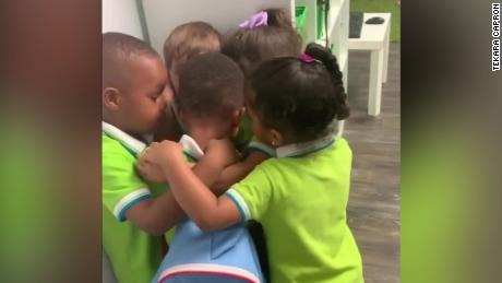 After surviving Hurricane Dorian in the Bahamas, a preschooler came home to a group hug from his classmates