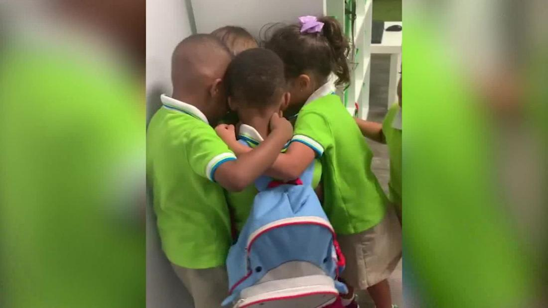 Kids embrace classmate who was stuck in hurricane