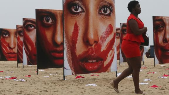 Images of models portraying women who have been abused at a demonstration opposing violence against women on Copacabana beach in 2016.