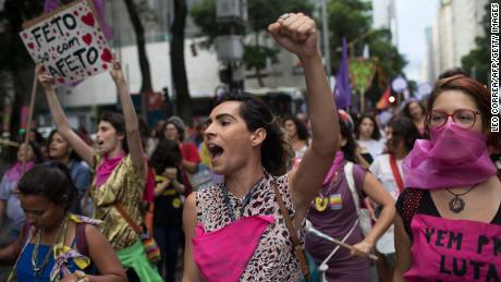 Women wear pink masks protesting violence against women in Rio de Janeiro, Brazil, on November 28, 2017.