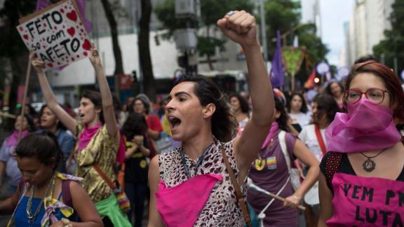 Women wear pink masks protesting violence against women in Rio de Janeiro, Brazil, on November 28, 2017.