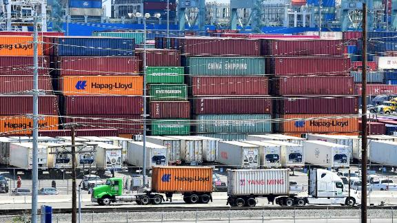 Container trucks arrive at the Port of Long Beach on August 23, 2019 in Long Beach, California. - President Donald Trump hit back at China on August 23, 2019, in their mounting trade war, raising existing and planned tariffs in retaliation for Beijing