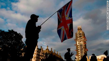 TOPSHOT - An anti-Brexit protester with a composite Union and EU flag is seen on Parliament Square outside the Houses of Parliament in central London on September 4, 2019. - British lawmakers inflicted a fresh defeat on Prime Minister Boris Johnson's Brexit strategy on Tuesday, approving in principle a law that could stop him taking Britain out of the European Union without a deal next month. (Photo by Tolga AKMEN / AFP)        (Photo credit should read TOLGA AKMEN/AFP/Getty Images)
