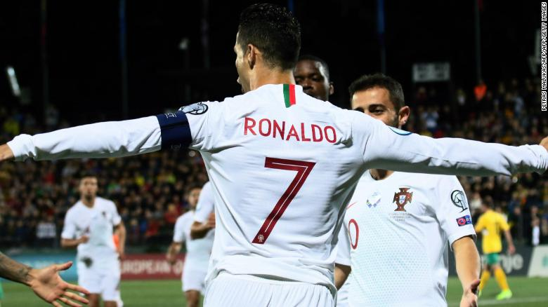 Cristiano Ronaldo celebrates his opening goal against Lithuania.