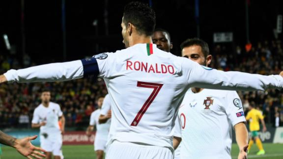 Cristiano Ronaldo celebrates his opening goal against Lithuania.