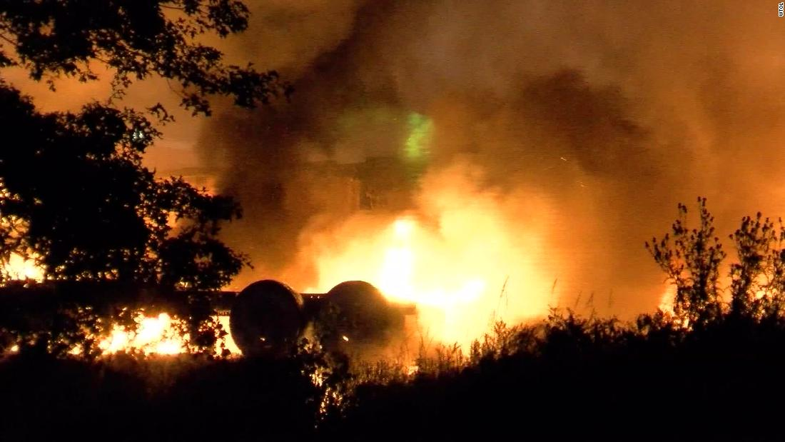 Plane crashes near Toledo airport, erupting into flames as it strikes unoccupied vehicles