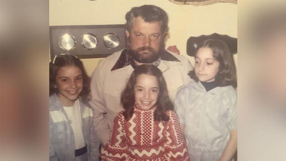The Heller sisters with their dad.