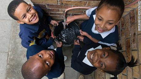 Schoolchildren at AF Louw Primary collect water during the Count Dropula project.